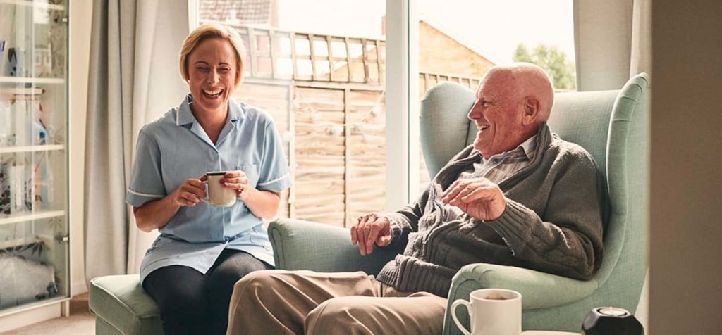 Wiltshire Community Image of care assistant and homeowner enjoying a brew